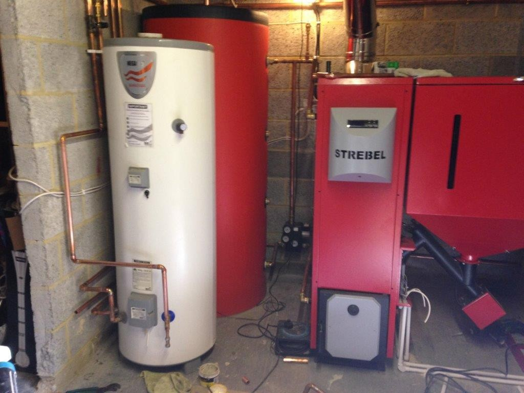 adapting oil central heating to biomass boilers pellets england